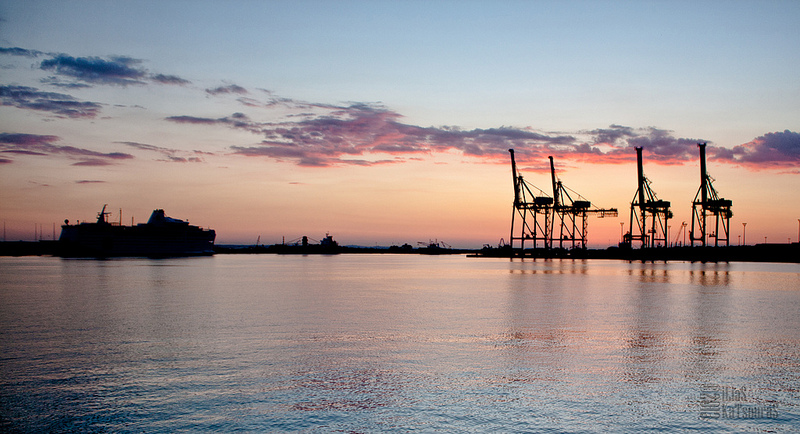 Dusk in the port of Limassol, with the cranes and some shadowy ships moored