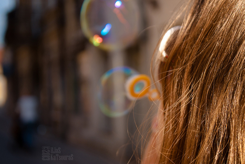 making soap bubbles unde the summer sun! Having fun!