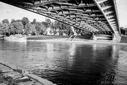 Mindaugas bridge in Vilnius, Neris river and a boat